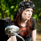 Red-haired biker girl Stock Images