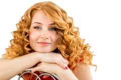 The red-haired blue-eyed girl with freckles and curly hair Stock Photography
