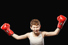 Red-haired boy champion boxer Stock Photo