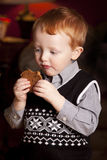 Red Haired Boy with Cookie Royalty Free Stock Images