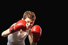 Red-haired boy with gloves Royalty Free Stock Images