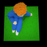 Red haired boy on the grass - 3d voxel art Stock Photography