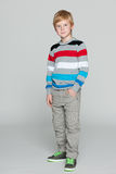Red-haired boy on the grey background Stock Photo