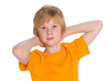 Red-haired boy imagines. A cute red-haired boy imagines on the white background stock images