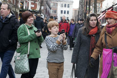 Red-haired boy takes pictures of the actor on the phone at Covent Garden Royalty Free Stock Photography