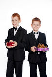 Red-haired boys with gifts Stock Image