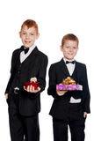Red-haired boys with gifts Stock Photography