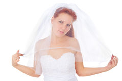 The red-haired bride covered with a veil Royalty Free Stock Image