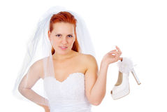 The red-haired bride keep a wedding shoes Royalty Free Stock Images