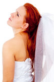 The red-haired bride looks to the side Stock Images