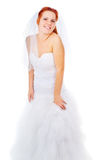 The red-haired bride posing in a wedding dress Royalty Free Stock Photos