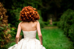 Red-haired bride is running Stock Photo