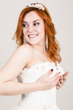 Red-haired bride in a wedding dress, bright unusual appearance. Beautiful wedding hairstyle and bright make-up Stock Image