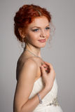Red haired bride in a wedding dress Stock Photography