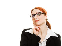 Red-haired businesswoman with glasses dreams. Stock Photography