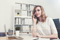 Red haired businesswoman on the phone Stock Photography