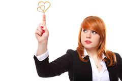 Red haired businesswoman showing pointing heart love symbol Stock Image
