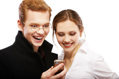 Red-haired couple with cellphone Royalty Free Stock Image