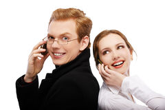 Red-haired couple with cellphones Stock Photos