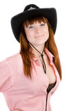 Red haired cowgirl in black hat Stock Photography