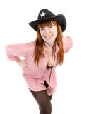 Red haired cowgirl in black hat Stock Images