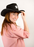 Red haired cowgirl in  hat looking to the camera Stock Photos