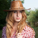 Red haired cowgirl Stock Image