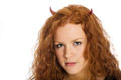 Red haired devil girl Stock Photo