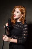 Red-haired diva singing song Royalty Free Stock Images