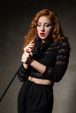 Red-haired diva singing song Royalty Free Stock Photo