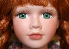 Red Haired Doll 1. Red haired porcelain doll with vivid green eyes stock image