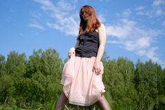 Red-haired  emo girl with yellow rose Royalty Free Stock Images