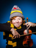 Red-haired expressive teenage boy playing violin, funny concept Stock Image