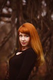 Red-haired face model girl in black woman dress Royalty Free Stock Images