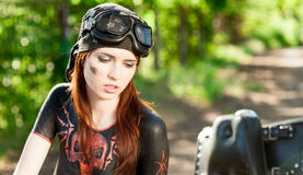 Red-haired female biker Stock Photography