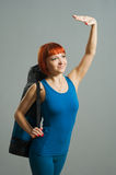 Red-haired fitness girl with yoga Royalty Free Stock Photo
