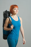 Red-haired fitness girl with yoga Royalty Free Stock Photos