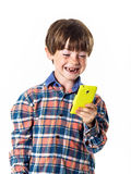 Red-haired funny boy with mobile phone Royalty Free Stock Photo