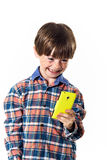 Red-haired funny boy with mobile phone Stock Photo