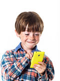 Red-haired funny boy with mobile phone Royalty Free Stock Images