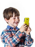 Red-haired funny boy with mobile phone Stock Images