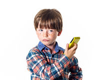 Red-haired funny boy with mobile phone Royalty Free Stock Photography