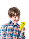 Red-haired funny boy with mobile phone Stock Photography