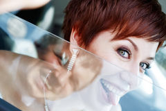 Red-haired funny bride in the car smiling groom. Woman 35 years. Weddiing Stock Photos