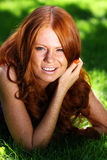 Red-haired girl Stock Photos