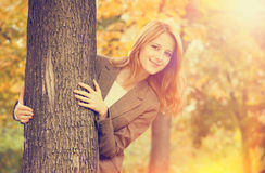 Red-haired girl in the autumn park. Royalty Free Stock Photo
