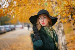 Red-haired girl in autumn park royalty free stock photos