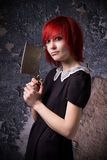 Red-haired girl with an ax Stock Photography