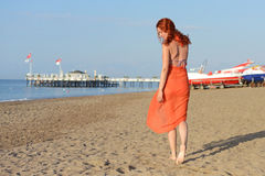 The red-haired girl on the background of the sea Royalty Free Stock Image