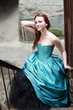 Red haired girl in the beautiful blue dress stock image